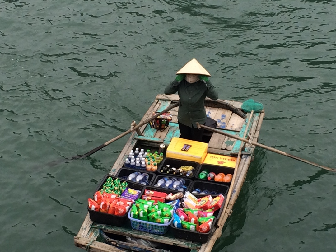 Rowing boat seller in halong bay vietnam