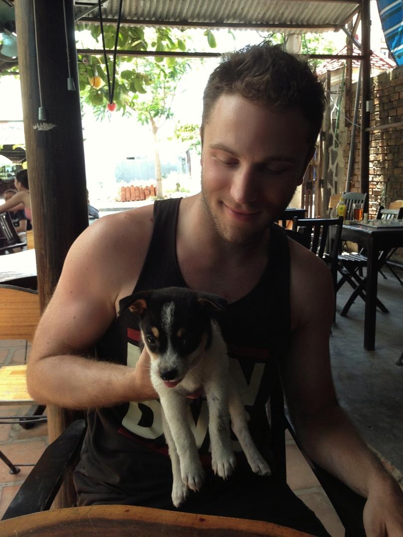 cuddling a puppy in hoi an