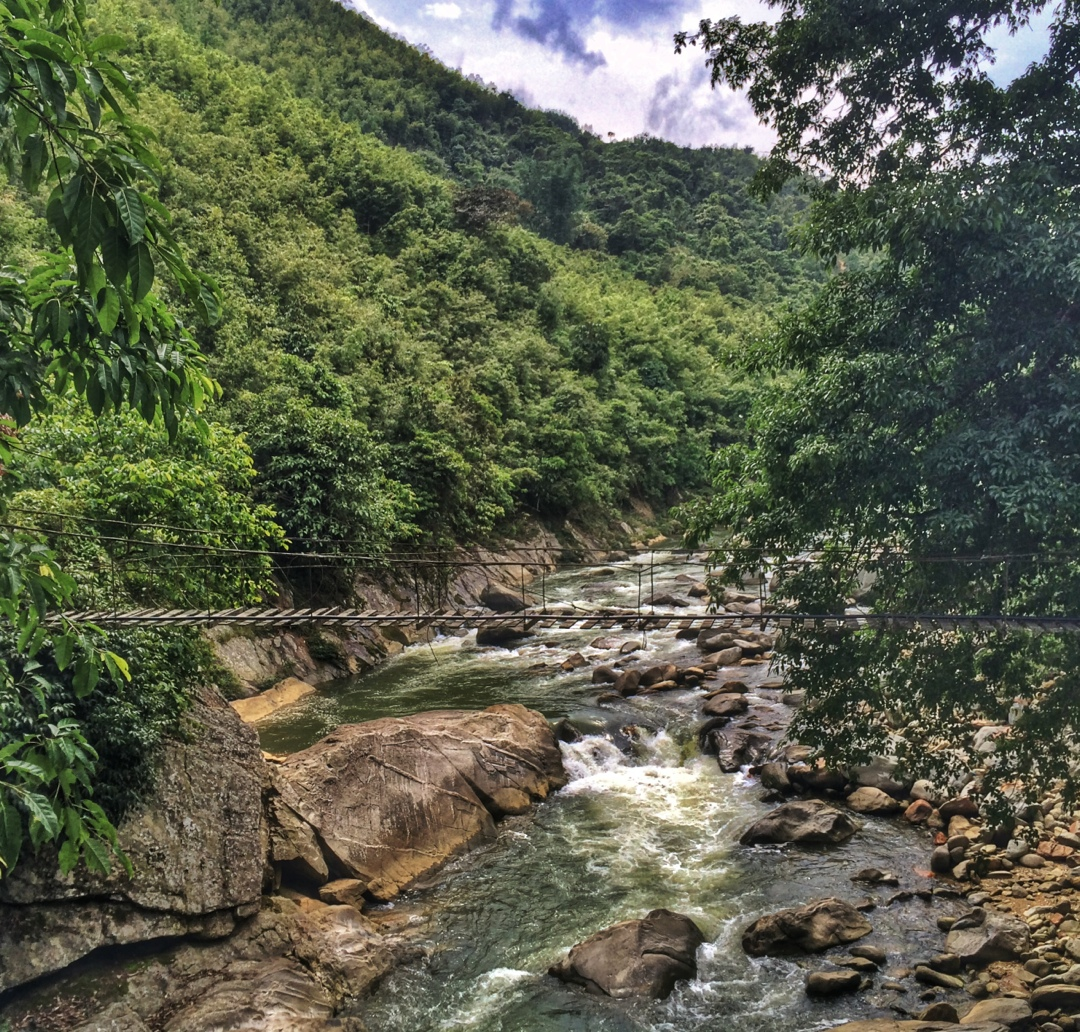 narrow bridge over river in sapa valley