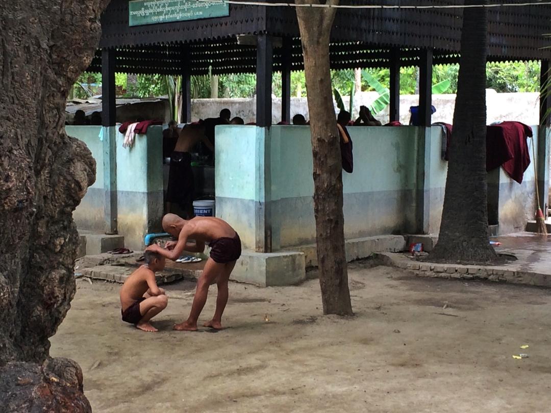 Monks shaving each others head