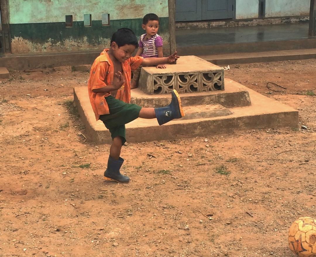 palaung boy playing soccer