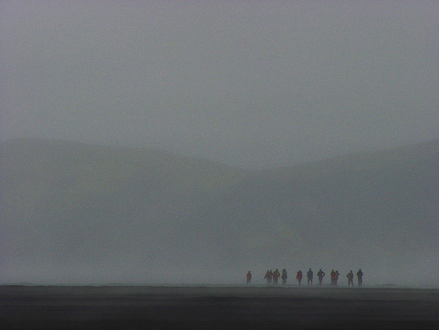A group of hikers disappearing in rain