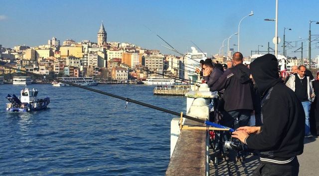 Hundreds of fishers work on Galata bridge in Istanbul